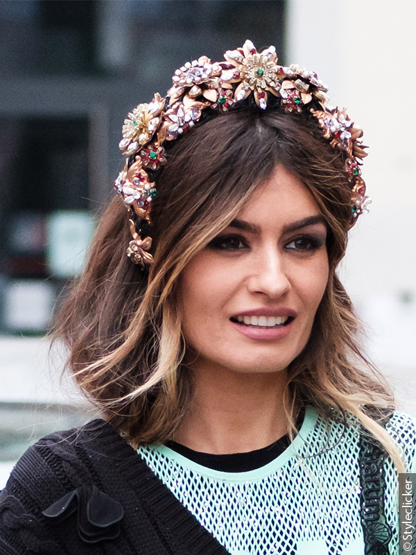 Woman with flower-adorned headband