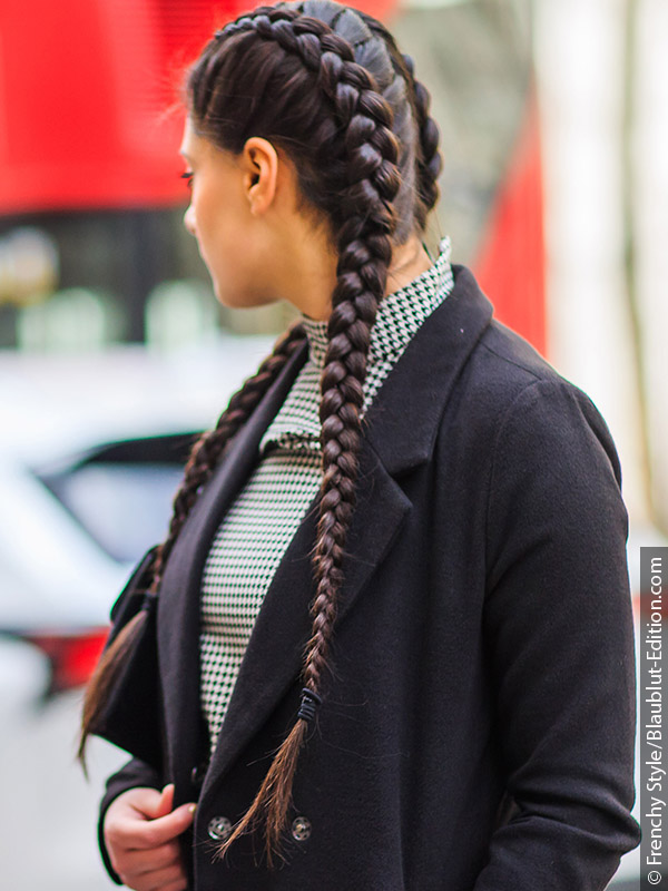 Woman with dark hair and Dutch braid