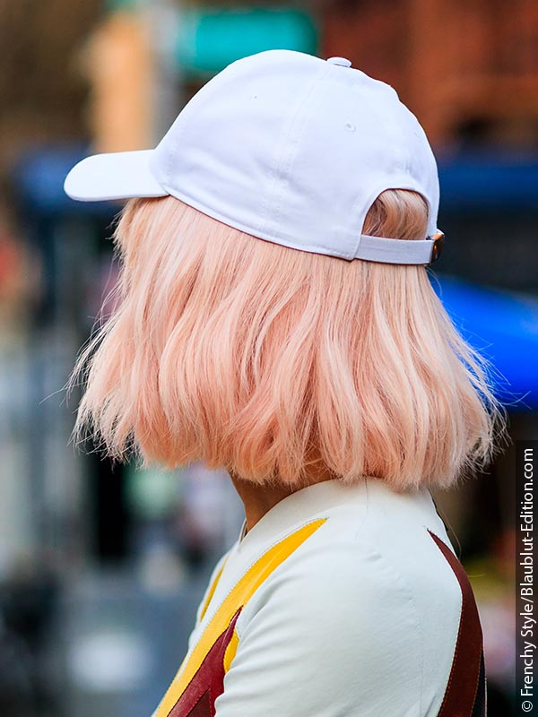 Woman with rose gold hair and cap