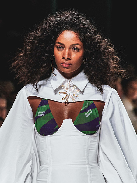 Model with naturally curly hair on the catwalk at Mercedes-Benz Fashion Week