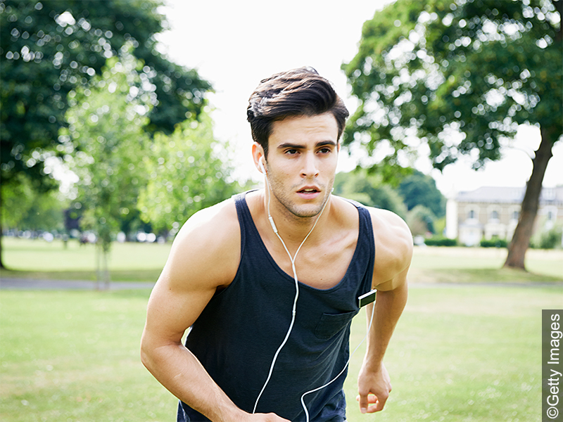 Man with short haircut while jogging