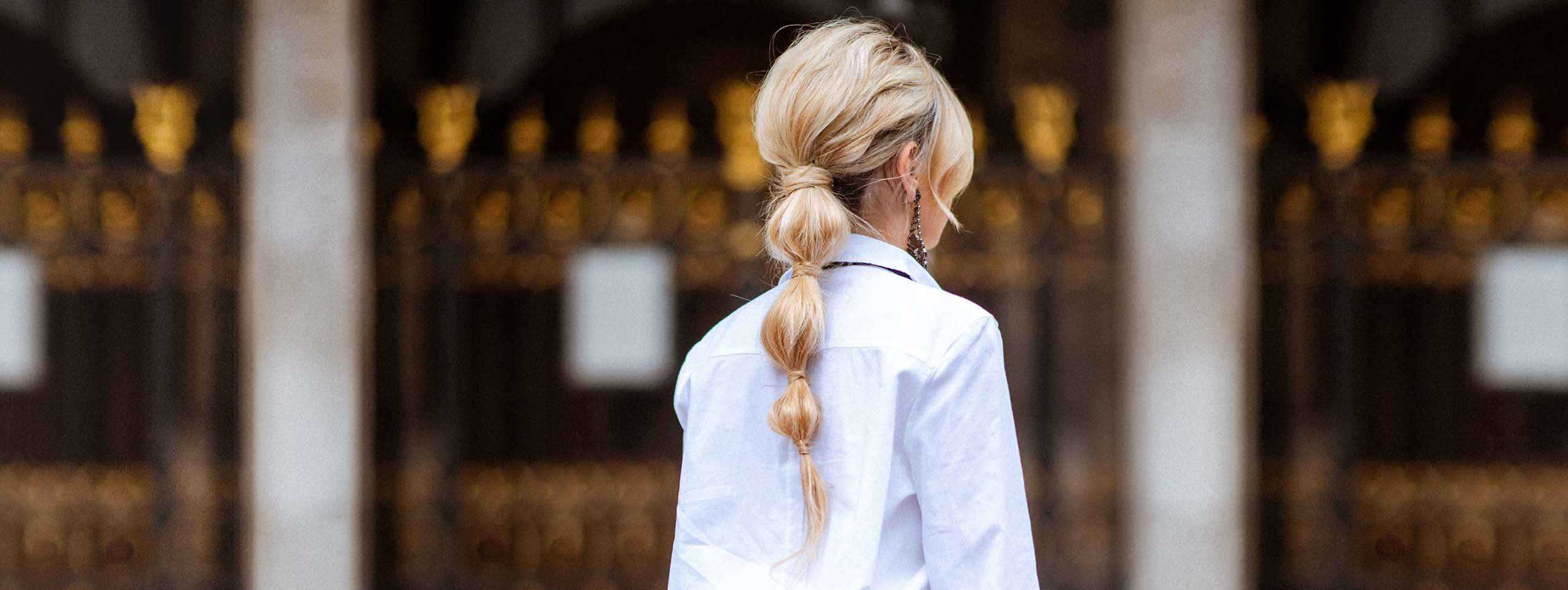 Blond woman with braided ponytail