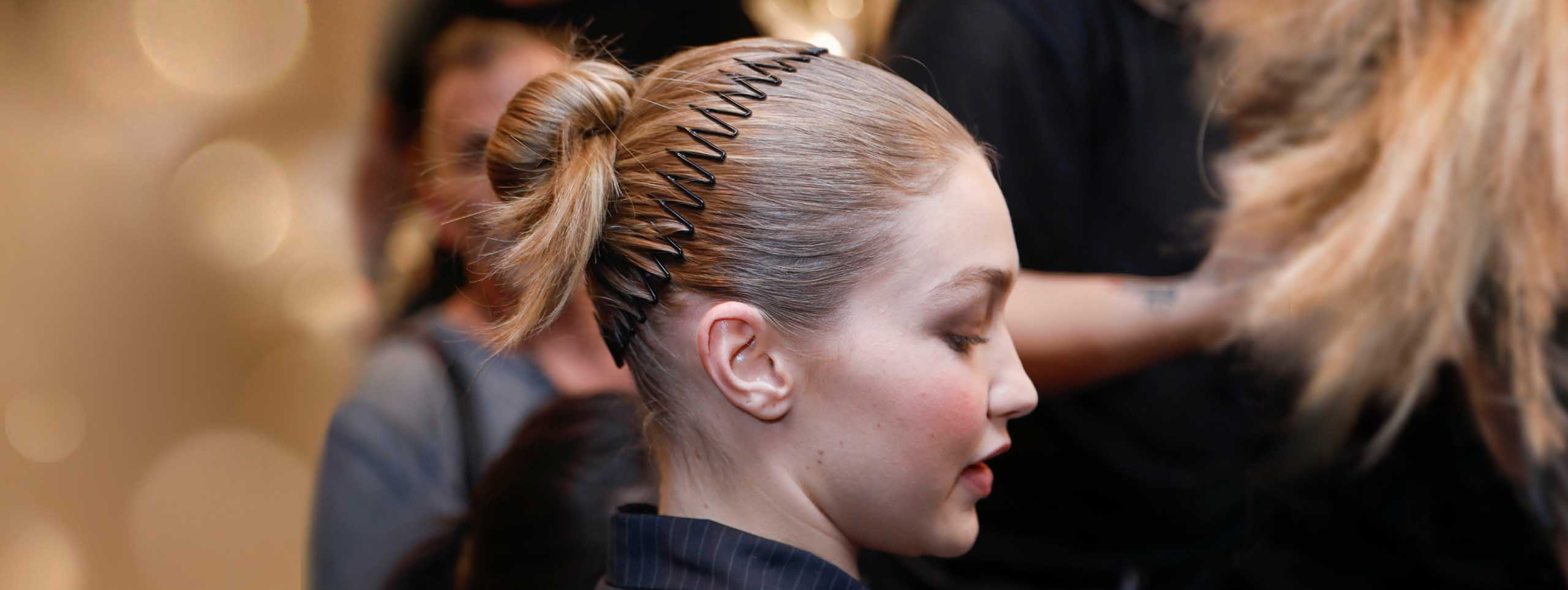Sideview of woman with zig-zag headband