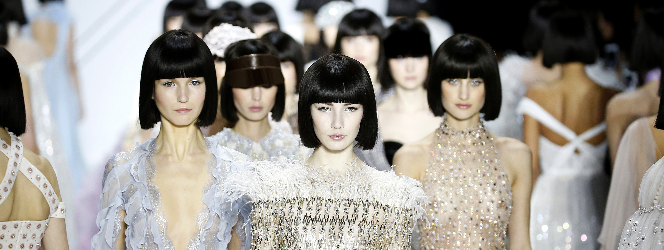 Model with fringe hairstyle on the catwalk.
